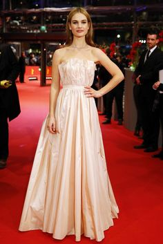 "Attending the Berlin Film Festival premiere of ""Cinderella"" on February 13th, actress Lily James looked perfectly princess-like in a pink dress from Dior."