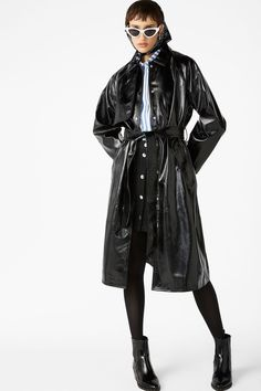 <p>A classic long trench with a glossy twist! Belted at the waist, snap fastening and slanted pockets. Yaaas!<br /><br />In a size small the chest width is
