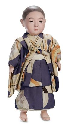 "Smaller Japanese Paper Mache Ichimatsu Doll in Original Costume and Box 14"" (36 cm.) Solid-domed paper mache swivel head on shoulder plate w..."