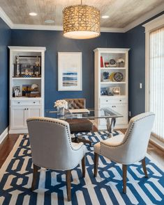 Traditional home office with blue walls and rug together with nice pendant lighting on a wooden regular ceiling. office ideas layout office ideas on a budget office ideas organization home offices home offices from home office ideas Home Office Colors, Home Office Space, Home Office Decor, Office Ideas, Home Decor, Office Rug, Home Office Paint Ideas, Office Ceiling, Office Setup