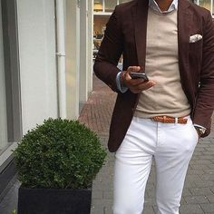 Wear a dark brown blazer and white trousers if you're going for a neat, stylish look.   Shop this look on Lookastic: https://lookastic.com/men/looks/blazer-crew-neck-sweater-long-sleeve-shirt/20064   — White Long Sleeve Shirt  — Beige Print Pocket Square  — Beige Crew-neck Sweater  — Dark Brown Blazer  — Tan Leather Belt  — White Chinos
