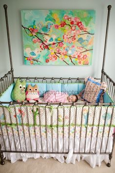 Beautiful nursery - Pottery Barn Kids. I especially love the painting above and the simplicity of the crib gives focus to everything else, so pretty !!