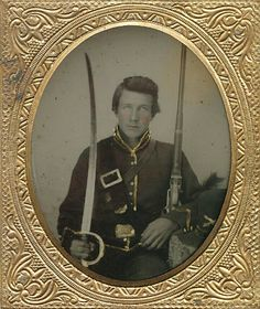 This one is identified on the back of the plate as James Absher of Co. F, 2nd Indiana Cavalry. James would enlist in early September 1861, and he would serve until his capture in the area of the Chattahoochie River. James is shown here dressed in his cavalry uniform with a carbine sling over one shoulder and the sling for his sword belt worn over the other. His massive cavalry saber is held up right propped up against his shoulder while he cradles his carbine in the other hand.