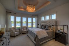 Master bedroom with sitting area, lots of windows. Vaulted ceiling with detail.