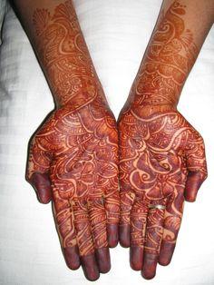 groom mehendi henna coloured hands