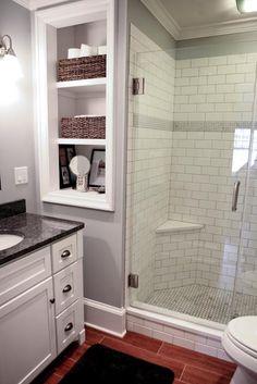 subway tile, carerra hex tile on shower floor, custom glass doors, steel gray granite counter, built in shelves, ceramic tile wood floor. Love my bathroom! Work done by Salt Point Services (www.saltpointservices.com)  www.stephanieantshel.com photography