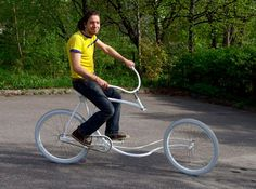 norweigan bicycle designer olli erkkila likes to push the limits of bike design, as proven by this design  that has no front fork. the all white forkless bike is erkkila's second forkless design and one of his many  odd creations. the design uses a modified frame that is steered using handlebars connected to a steering  rod that turns the front wheel. the frame is modified to support the rider in the absence of the front fork,   with added tubing below the seat. with this design and…