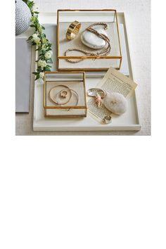 Des boîtes à bijoux en verre et métal doré