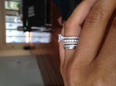 this is what i'm going for - solitaire engagement ring, wedding band and for a child down the road