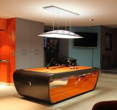 If It's Hip, It's Here: Black Light Billiard Tables by Toulet. Tons of Colors and Many Cool Options.