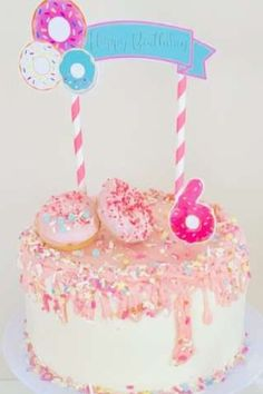 Take a look at this cute donuts birthday party! The cake is wonderful! See more party ideas and share yours at CatchMyParty.com #catchmyparty #partyideas #donuts #donutparty #girlbirthdayparty #cake