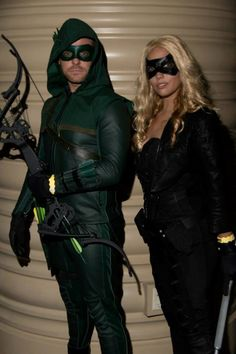 Mlcarr as CW Black Canary, her boyfriend, TJ McDonnell as CW Arrow at Megacon 2014.