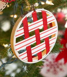 Weave high-contrast ribbon to create these simple ornaments. To do: Layer lengths within mini embroidery hoops (cut longer pieces for the center), using double-stick tape around the inner hoop to hold ribbon in place.  - GoodHousekeeping.com