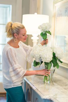 Keep flower arrangements lasting longer with three easy steps. I love making flower arrangements and these no fail steps will keep your flowers looking beautiful longer. Also, how pretty is this white blouse from Ann Taylor Loft? I love it and the teal blue pants. If hydrangeas wilting is happening, these three tricks will perk them right up!