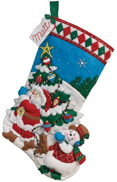"2013 Bucilla Felt Applique stocking kit special release (1 of 8): Pick a Tree. MerryStockings carries it for $12.99. This is a 16"" stocking."