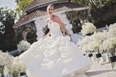 We're completely mesmerized by this stunning bride and gorgeous décor #white #wedding #Disneyland