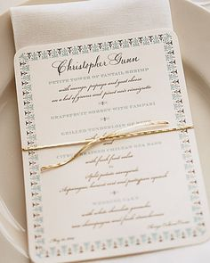 Formal Place-Card Menu: Letterpress menu cards, bound to napkins with gold cording, also serve as place cards.