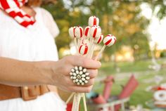 These peppermint lollipops would make a great centerpiece at a Christmas in July party!