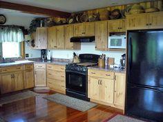 Cedar post & beam home Upstate NY, kitchen cupboards Knotty Alder/DuraSupreme