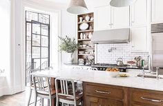 Beautiful white kitchen with a bit of wood contrast! Taphellip