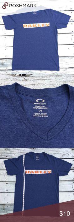Men's Oakley blue V neck t shirt size Large Preowned Men's Oakley blue V neck t shirt size Large Oakley Shirts Tees - Short Sleeve