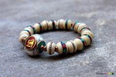 White Bone Tibetan Bead Stretch Bracelet  Inlaid by Spectrakraft, $35.00