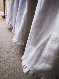 Italian linen crib skirt from 'birdshaveflowers' on etsy