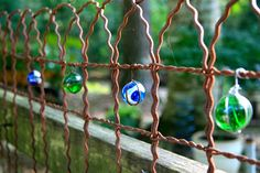 "I like this idea... 'Getting all your marbles in a row by Pandorea'... ("",)  Could do this on the chain link fence"