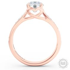 Award-Winning Round Solitaire Engagement Ring Handcrafted in Romantic Rose Gold. Signature Heart Crown Accentuated by 0.20ct Dazzling Diamond Shoulders. GIA Certified Stones. Matching Wedding Band For Her. Free Shipping USA. 30Day Returns | BASHERT JEWELRY | Boca Raton Florida