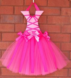 I have to make this for my girls. Tutu Bow Holder.