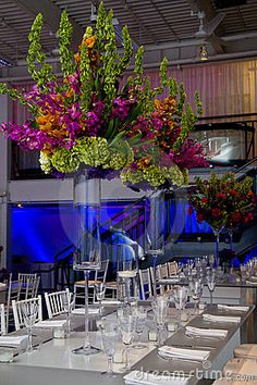 A Colorful flower arrangement on a wedding table. This is a big bouquet!