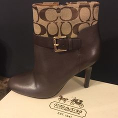 ! SALE Coach Ankle Boots/Booties! Brand new. Never worn. Coach Ankle Boot/Booties! These shoes are chocolate brown with the khaki brown Coach logo around the ankle and a silver buckle to seal the deal. They do come with a Coach shoe box. However, I just noticed that it isn't the original box. Shoes have been in storage and never worn. Size 7. Coach Shoes Ankle Boots & Booties