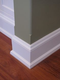 A way to merge from squared base boards into rounded wall corners