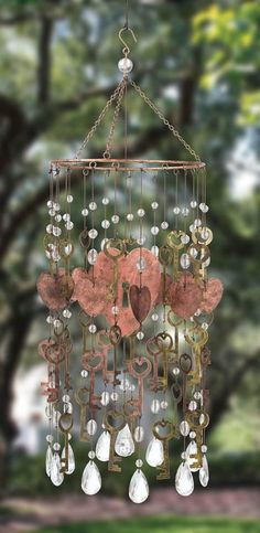 Wind chimes are one of the most popular garden ideas with some very different and unique designs. We bring you the 48 best DIY and upscale wind chimes. Make Wind Chimes, Glass Wind Chimes, Blowin' In The Wind, Acrylic Gems, Wire Art, Dream Catchers, Mobiles, Suncatchers, Garden Art