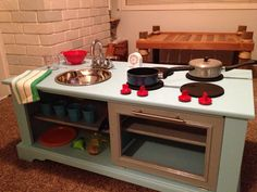 Play kitchen from an old TV cabinet
