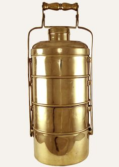 Delivering lunches to workplaces for over a century, the famed dabbawallahs of Bombay are known as much for their efficiency as they are for the quintessential tiffins they carry. This vintage, brass tiffin with four separate containers, stacks and snaps shut to keep its homely comfort food warm and secure. Approximately 40 years old.