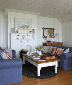 Cottage Style Living Room with Denim Blue Slipcover Sofas