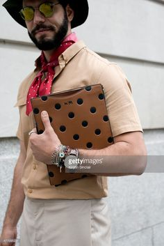 Fashion writer for I'Officiel homme Kadu Dantas wears a Topman hat, Gant scarf, Coach New York purse, Ray Ban sunglasses. on day 2 of London Collections: Men on June 13, 2015 in London, England.