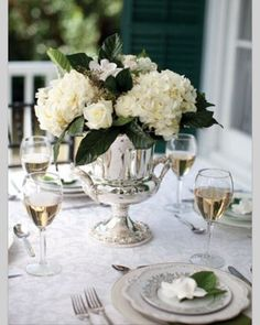 I love how clean and elegant this white table setting is