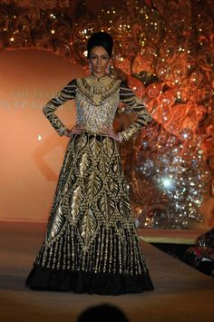 "Abu Jani and Sandeep Khosla presented their ""The Golden Peacock"" collection for a charity fashion show for the Sahachari Foundation"