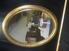 MIRROR OVAL SHAPED WITH GOLD PAINTED WOOD FRAME