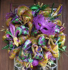This MARDI GRAS wreath is made with deluxe purple mesh and features all things Mardi Gras! Mardi Gras Wreath, Mardi Gras Decorations, Mardi Gras Party, Diy Wreath, Wreath Ideas, Deco Mesh Wreaths, How To Make Wreaths, Christmas Wreaths, Easter Wreaths