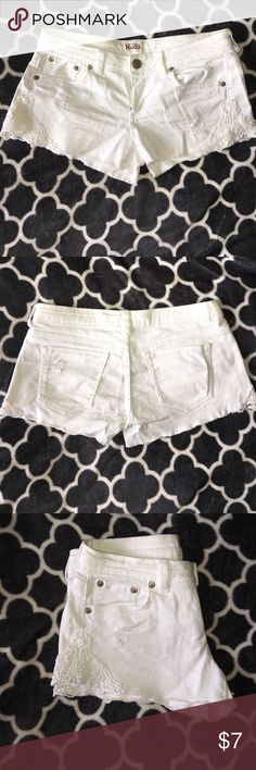 Distressed lace white shorts Distressed lace white shorts-used still with life left! Super cute lace on the sides Mudd Shorts Jean Shorts