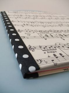 Cover notebooks with sheet music