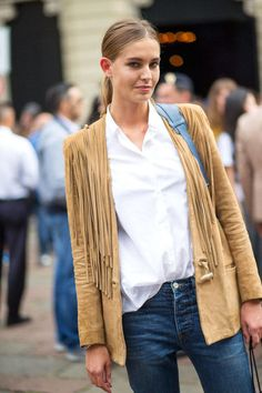 Camel suede jacket with a white shirt and blue jeans | Image via  harpersbazaar.com