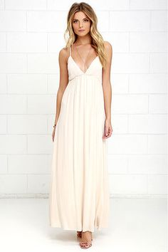Take a step out of the door in the Explore Every Avenue Light Beige Maxi Dress and you'll want to spend the day showing it off! Spaghetti straps tie above an open back, supporting darted cups. From a gathered, elastic waist, a breezy woven skirt falls to a maxi length.