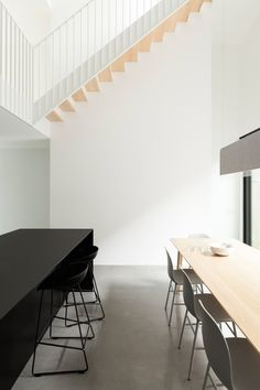 The limited floor area of this Montreal dwelling required Canadian firm La Shed Architecture to lay out the home's social spaces on two distinct levels.