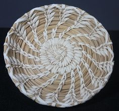 Tohono O'odham shallow coiled saucer with spiral wheat stitch.  This tidy spiral decorated saucer-shaped basket has integrity ! $55.00