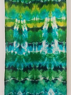 This hand dyed shibori scarf would make an amazing headband.  The color combination is really pretty and the pattern has a definite bohemian vibe.  Go to flygurl designs to see the entire collection.