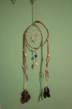 Dreamcatcher made whit: wood, shells, woolen thread and beads